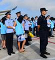 跨境诈骗 77人被押回国