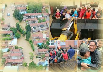 村庄被淹,铲车硬核救援