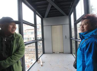老楼装电梯不少人更想平层入户