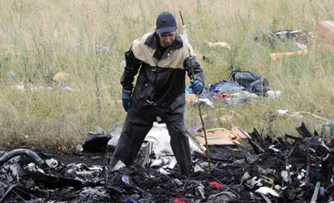 MH17航班黑匣子去向成谜 调查或需数月